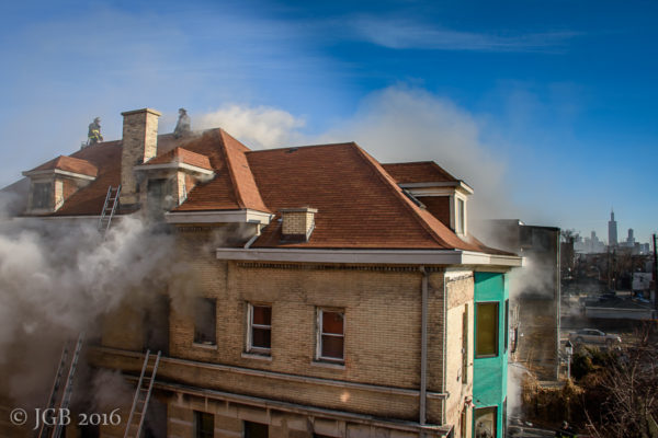 smoke billows from large home