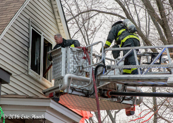 firefighters in tower ladder basket