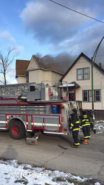 Firefighters arrive at house fire