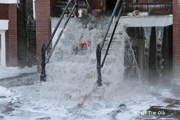 water gushes from fire building