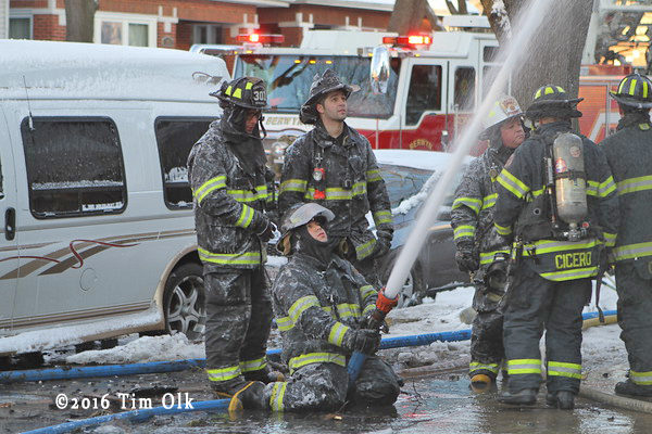 Firefighters encrusted in ice at fire scene