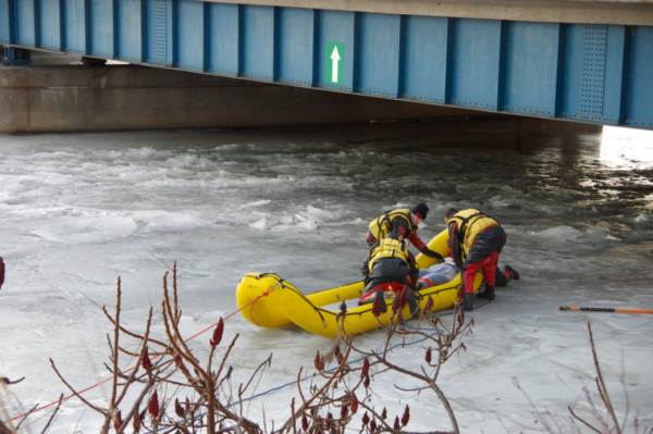 firefighters rescue victim on frozen river