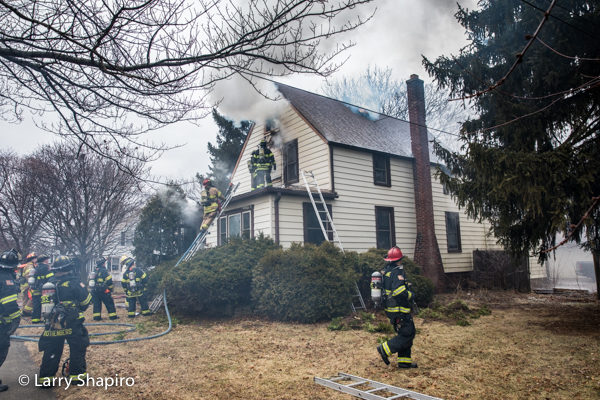Firefighters battle house fire with heavy smoke