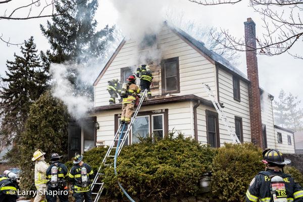 Firefighters battle house fire with heavy smoke