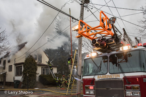 utility worker cuts electric lines during house fire