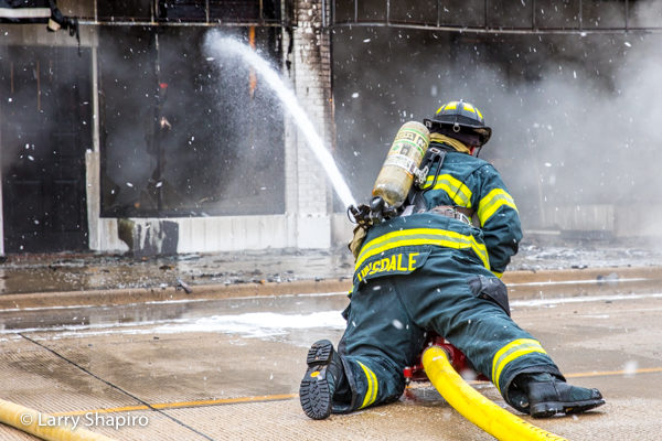 dramatic photo of Firefighter with hose