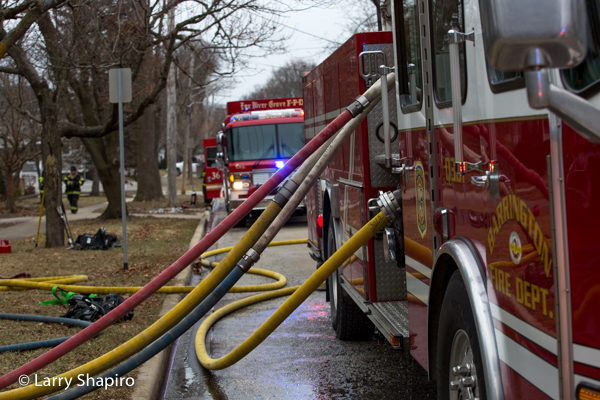 multiple lines off E-ONE quint af fire scene