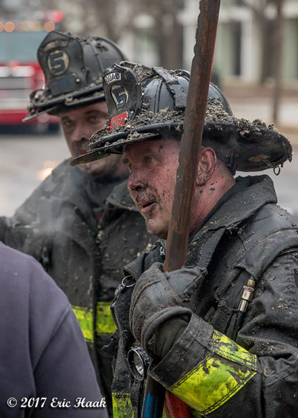 firefighters with dirty faces