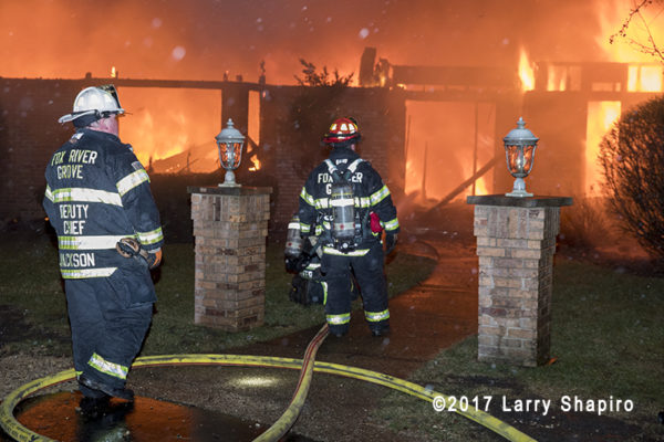 firefighters battle fire that destroys a huge mansion