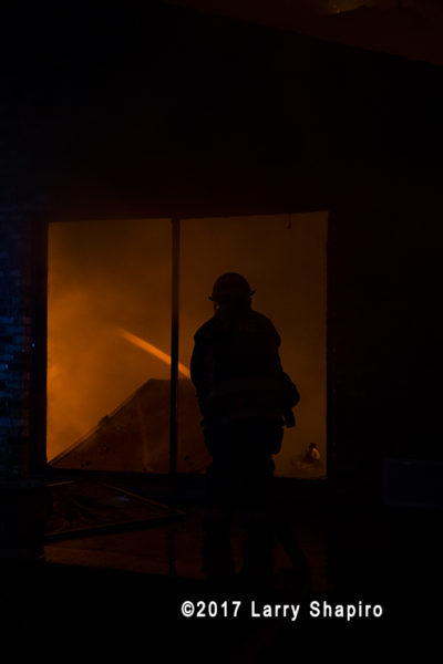 firefighter silhouette with fire