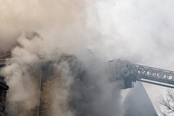 firefighters engulfed in smoke