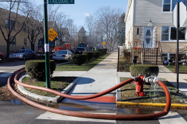 fire hydrant with two lines attached
