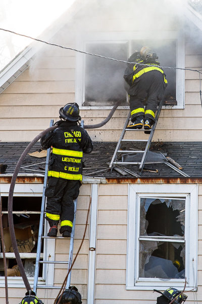 firefighters work at a house fire