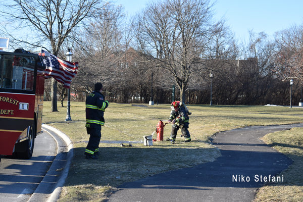 firefighter opens a hydrant