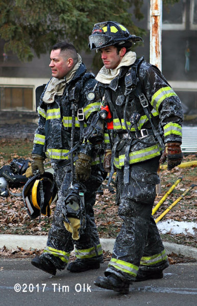 firefighters covered with ice