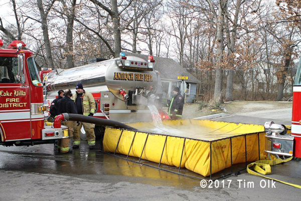 fire tender dumping into portable tank