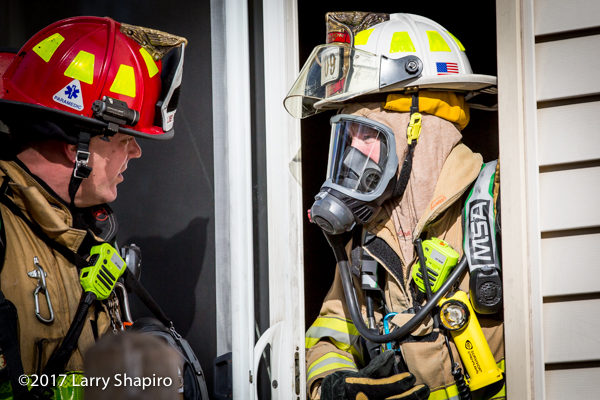 FD lieutenant and battalion chief confer at fire scene