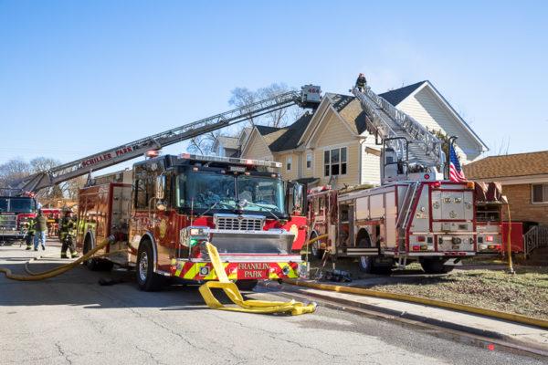 fire trucks at townhouse fire scene