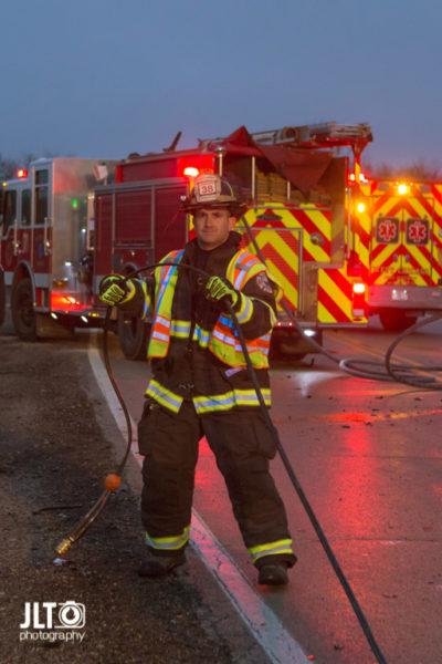 firefighter picks up tools after crash