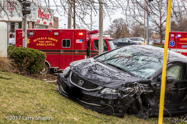 Buffalo Grove FD Ambulance 26 and a car against pole after crash