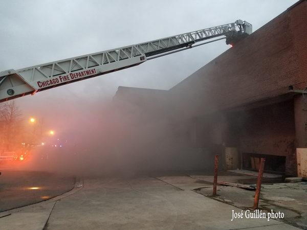 fire truck at smokey warehouse fire