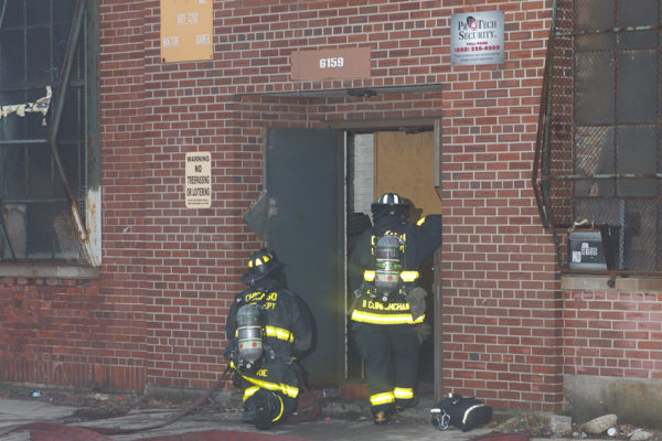 Firefighters with PPE at warehouse fire