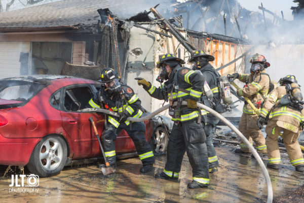 firefighters overhaul after house fire