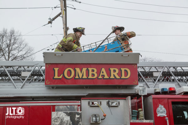 firefighters remove stokes basket from fire truck