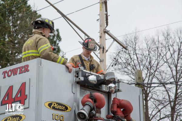 firefighters in tower ladder platform