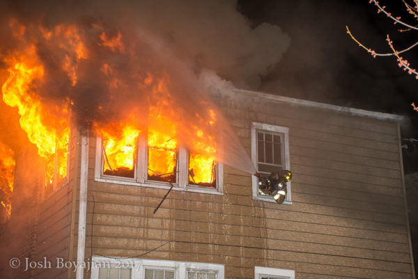 flames shoot from building window