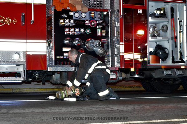 firefighter replacing SCBA bottle at scene
