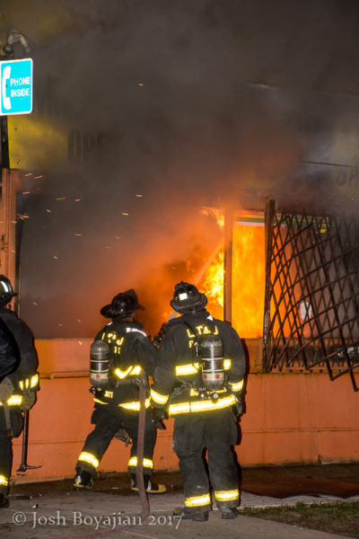 Chicago firefighters battle fire in a corner store
