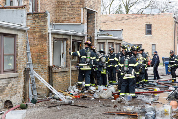 firefighters overhaul at fire scene