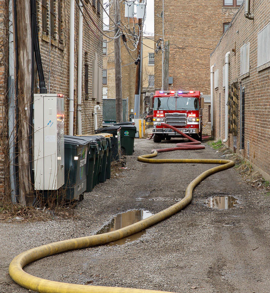 fire engine and hose in alley