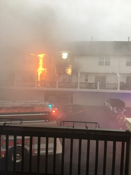 apartment deck engulfed in flames