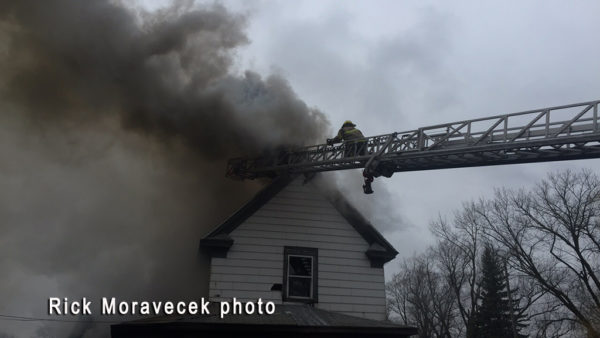 firefighter on ladder tip at house fire