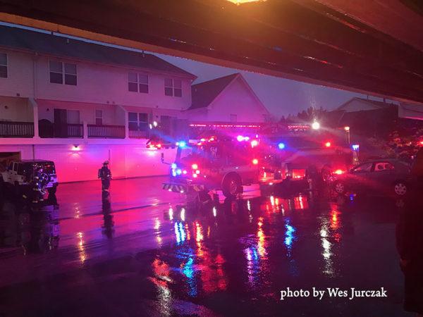 fire truck at fire scene n the rain