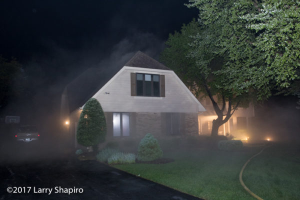 smoke pushes from everywhere as basement fire rages in a house