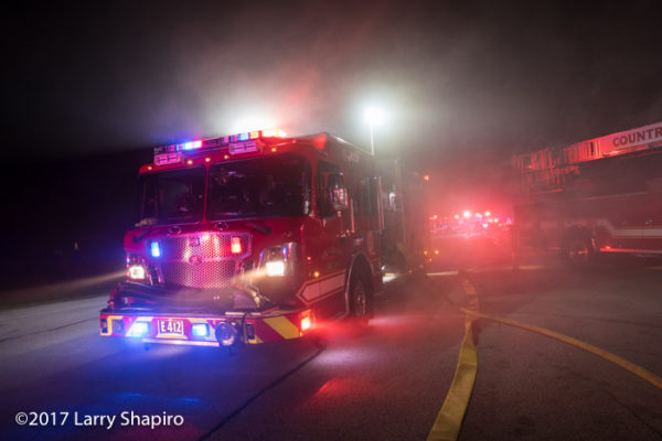 Spartan Evolution fire engine at night engulfed in smoke