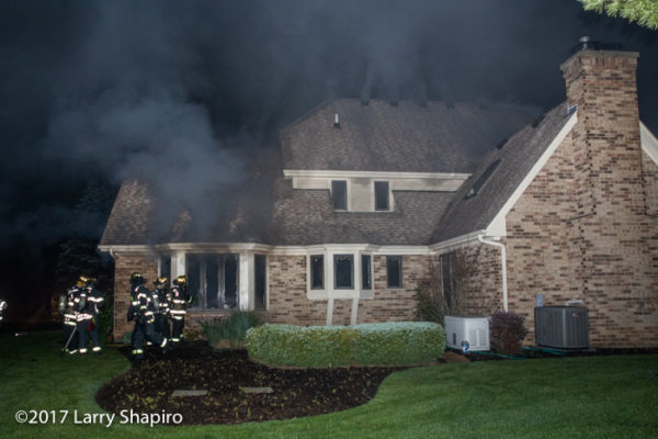 heavy smoke pushes from house fire
