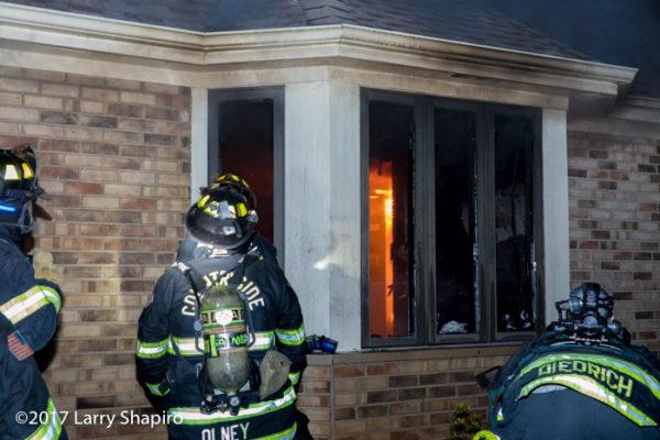 flames burn inside house