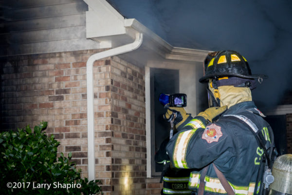 firefighter uses TIC to check for fire