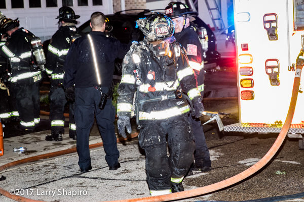 Firefighter in PPE covered with insulation after overhaul