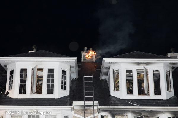 flames burning through chimney