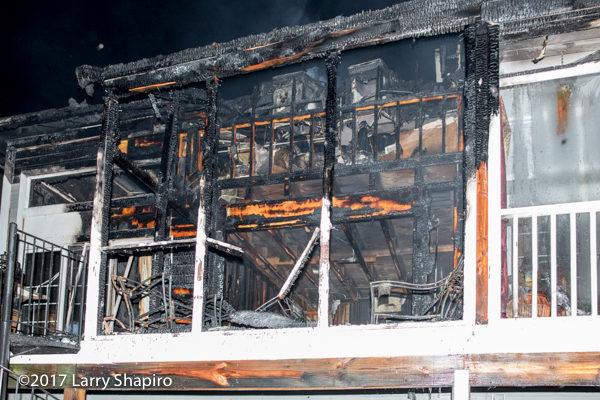 aftermath of townhouse damaged by fire