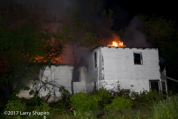firefighters battle fire in a vacant house