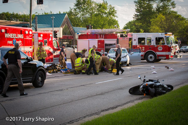 Firefighter/paramedics assist multiple patients at crash site with Stryker cots