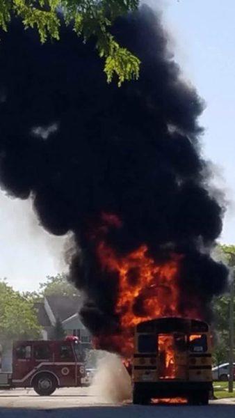 school bus engulfed in fire