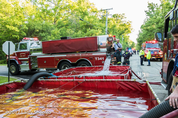 fire department tanker dumps into portable tank