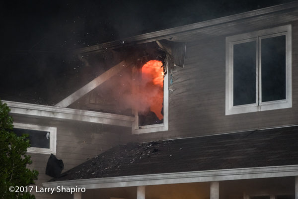 flames from window of house on fire